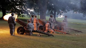 Soldiers fire artillery for a salute to the Union on July 4th, 2013, at Fort Leavenworth, Kansas, where Chelsea Manning was detained.