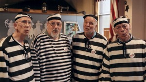 "A barbershop quartet dressed as prisoners entertain guests at a saloon in Fort Leavenworth, Kansas, also known as ""Prison City."""
